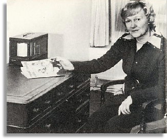 Beth Baylay sitting at the antique desk presented to her by the Club on her retirement. Photo: Budgett